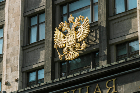 Coat of arms of Russia on the facade building of the State Duma of the Russian Federation