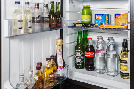 Moscow, Russia - February 23, 2017: mini bar with soft drinks, vodka, wine and beer in the hotel room at Crown Plaza 에디토리얼