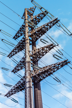 structure of the high-voltage electrical metal supports against the sky Stock Photo