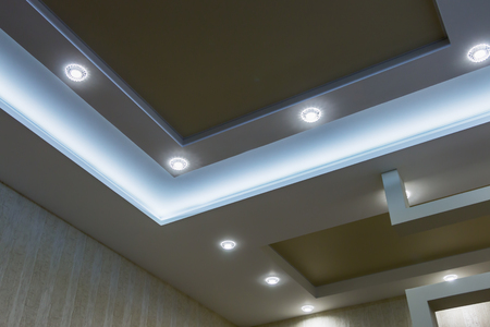 suspended ceiling and drywall construction in the decoration of the apartment or house. focus on coal structures Imagens