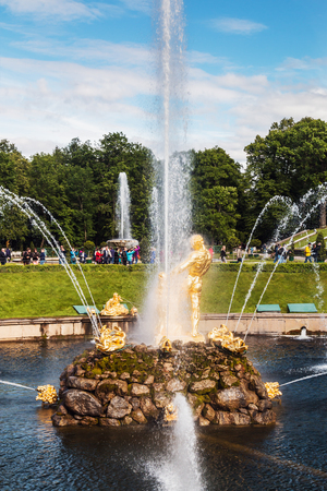 ST PETERSBURG, RUSSIA - July 07, 2017: Tourists in Peterhof the fountains of the lower Park in Peterhof. The Peterhof Palace included in the UNESCO s World Heritage List
