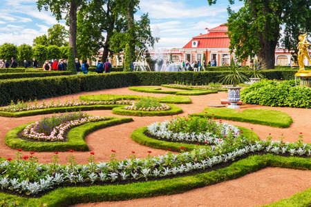 ST PETERSBURG, RUSSIA - JUNE 21, 2015: Tourists in Peterhof at Garden of Monplaisir palace. The Peterhof Palace included in the UNESCOs World Heritage List