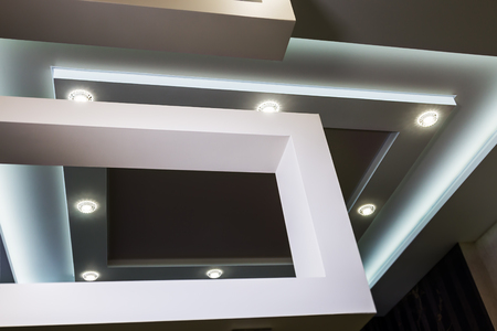 suspended ceiling and drywall construction in the decoration of the apartment or house. focus on the spot