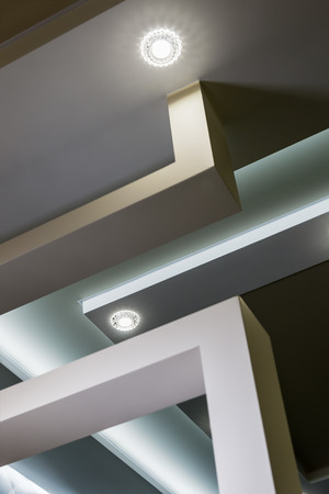 modern interior room with tiered ceilings and partitions. Modern technologies of construction and interior Stock Photo