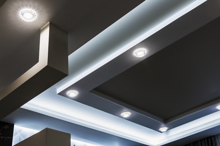 suspended ceiling and drywall construction in the decoration of the apartment or house. Decorative trends in interior design for the house and office. Modern construction materials
