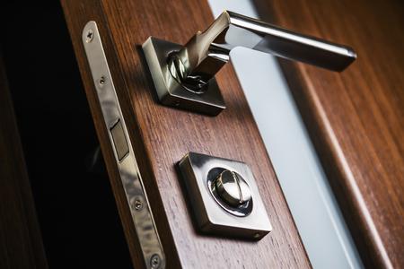 door handle and latch of brass on veneer doors Imagens - 92035561