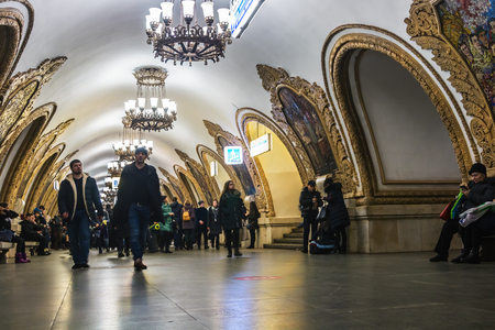 Moscow, Russia - December 16, 2017: passengers and tourists at the metro station Kievskaya in Moscow ring. Russia