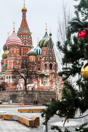St. Basils Cathedral and Christmas tree in the new year holidays in Moscow.