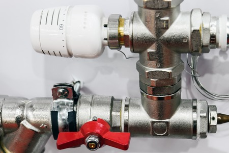 fittings and valve, pipes and adapters. Plumbing fixtures and piping parts. focus on the red crane