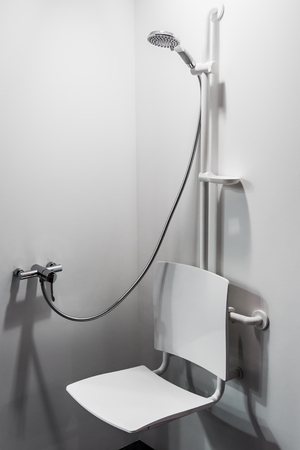 shower with seat and grab bars for disabled and elderly people in the bathroom Reklamní fotografie - 96378319
