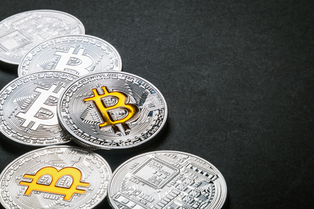 bitcoin coins on a black background. bitcoin is the most popular cryptocurrency in the world. bitcoin is the first cryptocurrency in the world Zdjęcie Seryjne