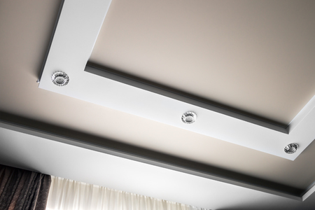 multilevel suspended and suspended ceiling of plasterboard. modern interior