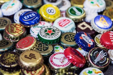 Moscow, Russia - April 22, 2018: Background of beer bottle caps, a mix of various global brands: Grolsch, Bud, Bavaria, Miller, Heineken Baltika corona extra etc