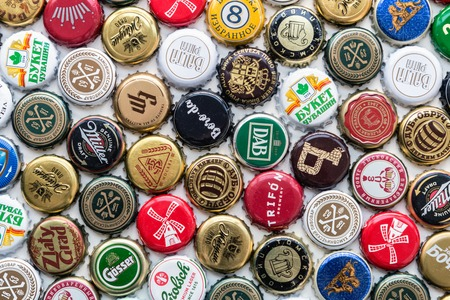 Moscow, Russia-may 30, 2018: beer bottle caps background, mix of different world brands: grolsch, Bud, Bavaria, Miller, Heineken, Baltika; Corona Extra, etc.