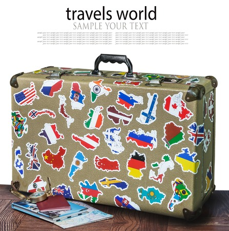 retro suitcase with stickers on the floor isolated on white background Stockfoto