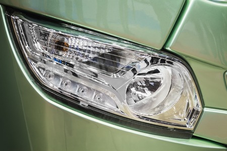 front light of a car, bus or truck. Modern led and halogen lighting