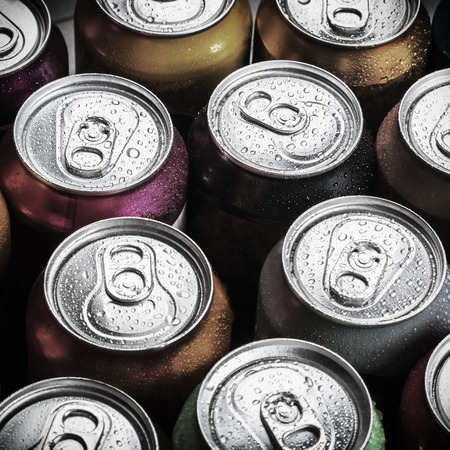 aluminum cans of soda background. view from the top. Toned image