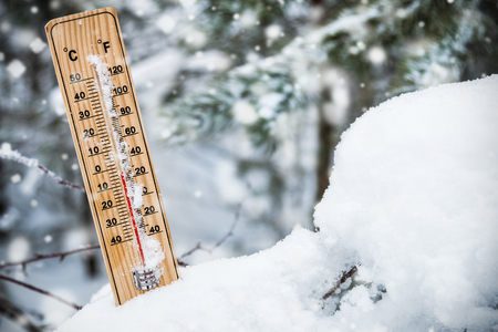 thermometer with subzero temperature stuck in the snow in the winter forest Stock fotó