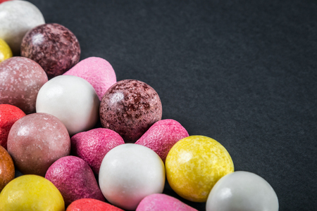 chewing gum, candy, chewing candy and other sweets on black background