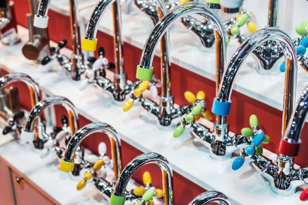 different models and manufacturers of faucets for plumbing work. Plumbing, heating pipes and fittings for connection of water