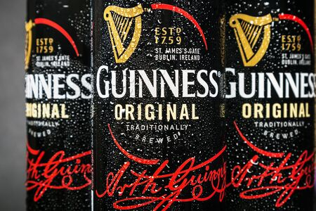 Moscow, Russia - March 28, 2019: logo on aluminum cans of Guinness beer. Guinness beer brand, originally belonged to the Irish company Arthur Guinness Son Co, founded in 1759