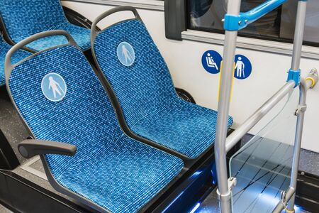 modern city bus or bus with seats for the disabled, the elderly, dogs and mothers with children
