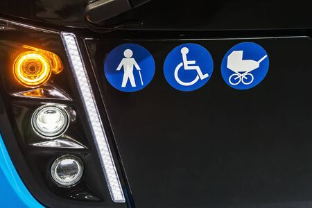 signs on front of bus or electric bus wheelchairs, prams, elderly people