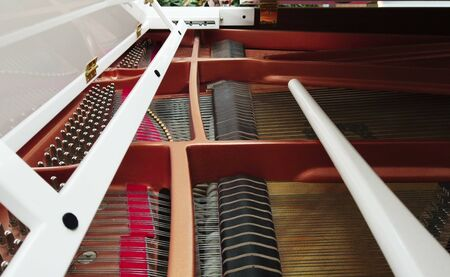 white electric piano plays music itself. the internal structure of the piano Stock fotó