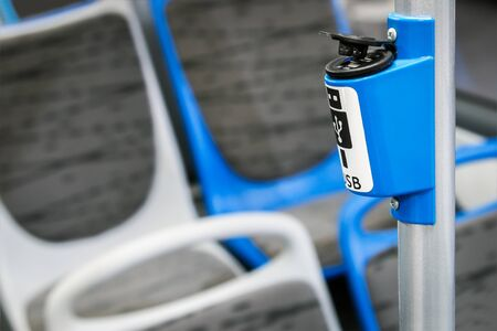 USB bracket for connecting and charging gadgets and smartphones in a modern bus, electric bus or tram