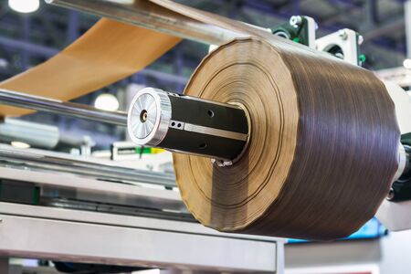machine for applying the laminated film on wooden surface. Focus on melamine film roll