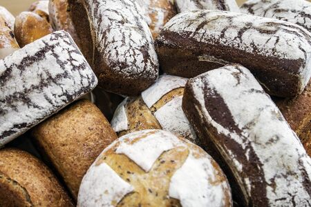 different varieties and types of bread. Loaves, rolls, loaves and other bread background