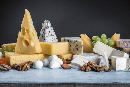 different varieties and types of cheese with fruit, nuts