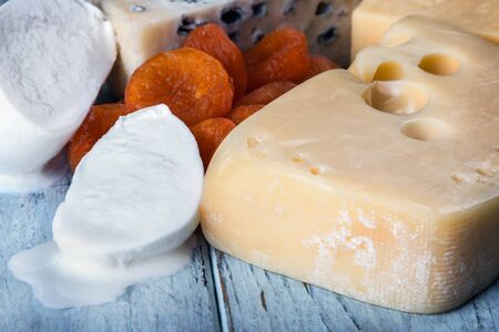 types of different cheese mozzarella, brie, Roquefort, Maasdam, etc. on the table with nuts Stock fotó - 136385462