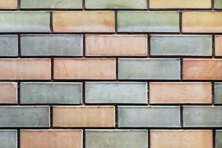 brickwork of different colors of bricks. The background of bricks Фото со стока