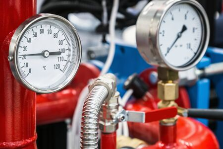 pressure manometer for measuring installed in water or gas systems. focus on the pressure manometer. Plumbing equipment, fittings, pipes, faucets, etc.