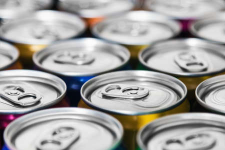 aluminum cans with carbonated water, energy drinks or beer. Background of aluminum cans Imagens