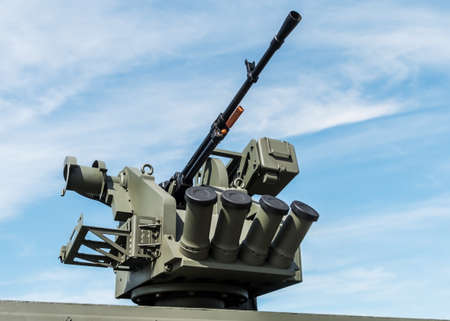 heavy machine gun mounted on the turret of a tank or infantry fighting vehicle