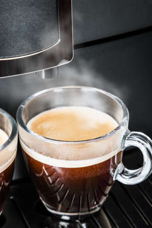 two glass Cup of coffee Prepared on the coffee machine