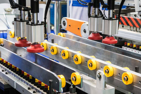 the drilling and welding machine is located in the wood and lumber processing shop