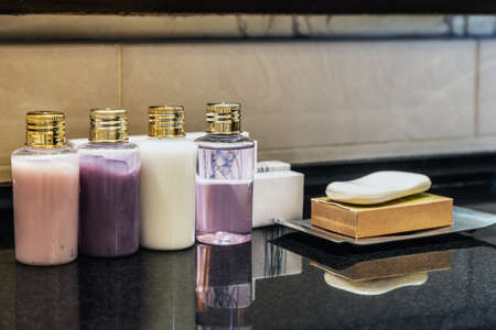 Mini bottles of cosmetics on the table in the hotel