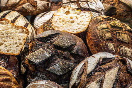 many different types of bread. Wholegrain, round, rolls and loaves
