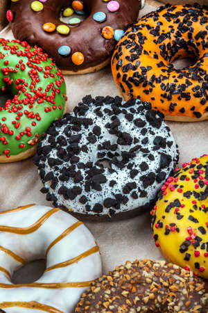 donuts with different flavors of glaze in a cardboard
