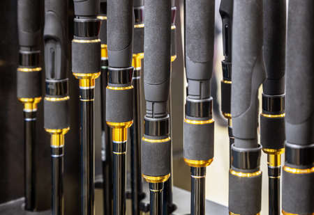 fishing rods of different construction and purpose on the counter Foto de archivo