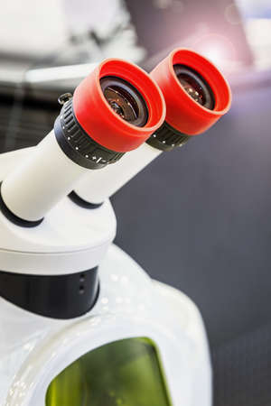 microscope lenses and eyepieces in a laboratory or training center
