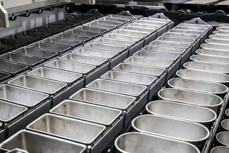 molds on the conveyor for baking bread at the bakery