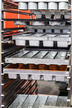 empty metal molds, trays and racks for baking bread and bakery products in a bakery Foto de archivo