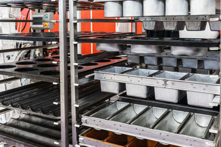 empty metal molds, trays and racks for baking bread and bakery products