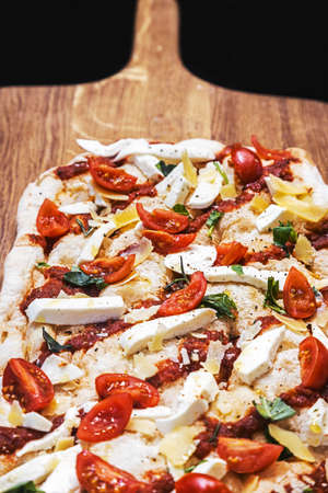 classic Italian pizza with mozzarella, tomatoes and basil