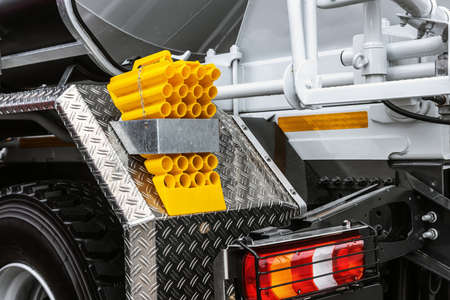 yellow locking block for truck attached to the body of the car.