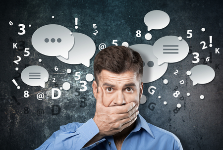 silenced: Handsome businessman closing his mouth with palms Stock Photo